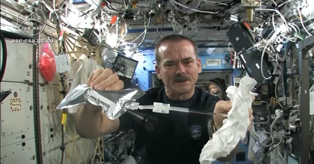 Astronaut Wrings Washcloth in Space