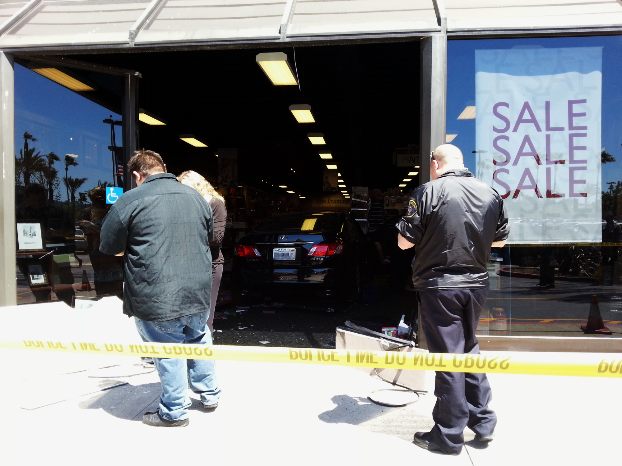 Car Inside Aaron Brothers Storefront